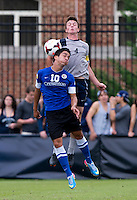Joey Dillon (4) of Georgetown goes up for a header with Ricardo Perez (10) of Creighton during the game at Shaw Field on the campus of the Georgetown University in Washington, DC.  Georgetown tied Creighton, 0-0, in double overtime.
