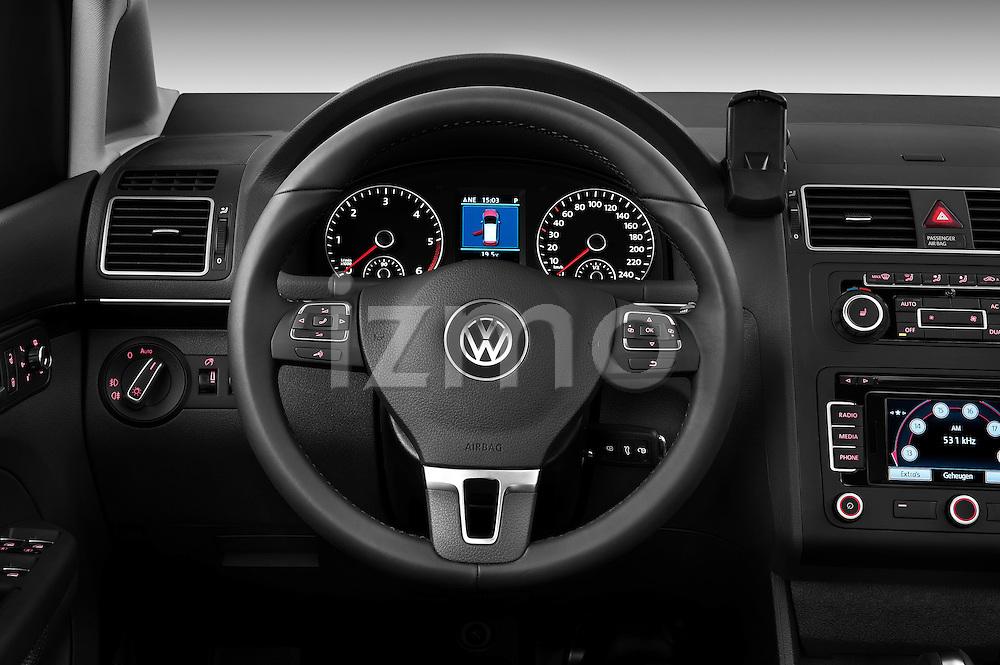 Steering wheel view of a 2010 Volkswagen Touran Highline 5 Door Mini MPV