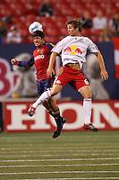 Real Salt Lake forward (11) Alecko Eskandarian and New York Red Bulls defender (60) Jeff Parke go up for a header. The NY Red Bulls and Real Salt lake played to a 2-2 tie in an MLS regular season match at Giants Stadium, East Rutherford, NJ, on September 29, 2007.