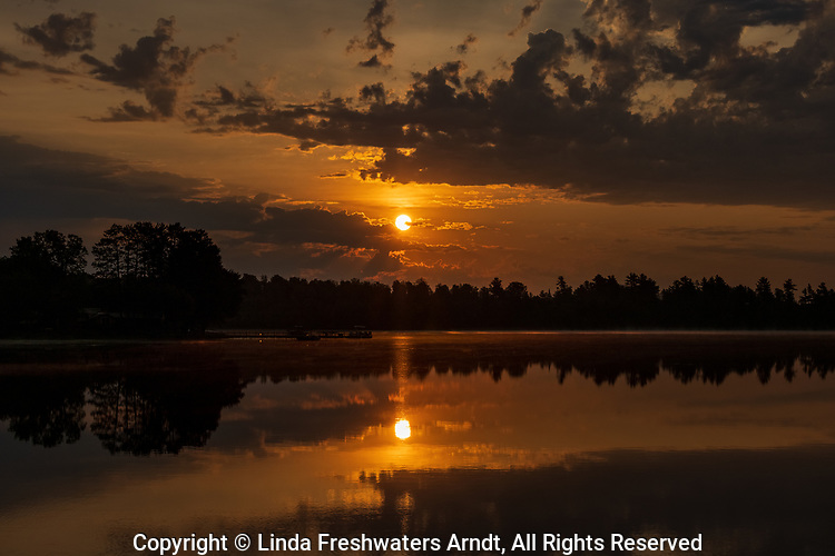 Sunrise over Blaisdell Lake in northern Wisconsin.