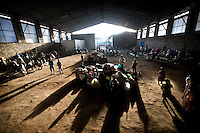 People shelter in a hangar belonging to the Don Bosco orphanage in the Kibati camp for displaced people, where thousands have fled to after renewed fighting in the region.