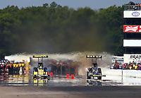 Aug. 17, 2013; Brainerd, MN, USA: NHRA top fuel dragster driver Morgan Lucas (left) races alongside Khalid Albalooshi during qualifying for the Lucas Oil Nationals at Brainerd International Raceway. Mandatory Credit: Mark J. Rebilas-