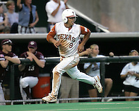 Texas DH Michael Torres scores against Texas A&M on May 16th, 2008 in Austin Texas. Photo by Andrew Woolley / Four Seam Images.