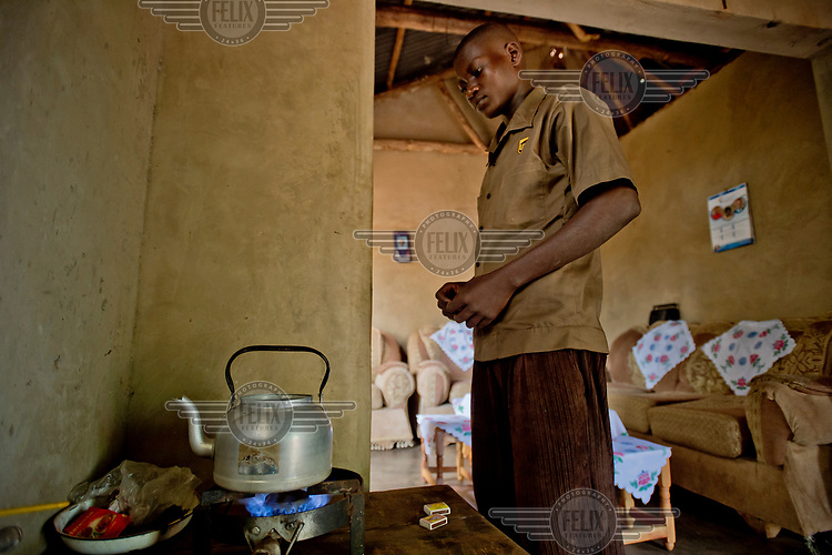 In Kayounga district, 60 kilometres from Kampala, a young man heats a kettle of water on a gas fuelled stove. It is supplied by gas produced from animal dung in a fermentation tank in the yard of the family house. The fermentation product, the result of a biogas process, supplies the house with gas, for light and for cooking.