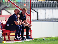 Oxford United's goalkeeping coach Wayne Brown, left, and Oxford United manager Karl Robinson in the dugout<br /> <br /> Photographer Andrew Vaughan/CameraSport<br /> <br /> The EFL Sky Bet League One - Saturday 12th September  2020 - Lincoln City v Oxford United - LNER Stadium - Lincoln<br /> <br /> World Copyright © 2020 CameraSport. All rights reserved. 43 Linden Ave. Countesthorpe. Leicester. England. LE8 5PG - Tel: +44 (0) 116 277 4147 - admin@camerasport.com - www.camerasport.com - Lincoln City v Oxford United