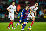 Lionel Andres Messi of FC Barcelona (C) fights for the ball with Guido Hernan Pizarro of Sevilla FC (R) during the La Liga 2017-18 match between FC Barcelona and Sevilla FC at Camp Nou on November 04 2017 in Barcelona, Spain. Photo by Vicens Gimenez / Power Sport Images