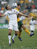 LA Galaxy's Herculez Gomez battles with DC United's Bryan Namoff. LA Galaxy tied DC United 1-1 during a MLS game at The Home Depot Center in Carson, California Sunday June 11, 2006.