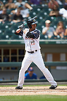 Ivan De Jesus Jr. (12) of the Charlotte Knights at bat against the Durham Bulls at BB&T BallPark on May 27, 2019 in Charlotte, North Carolina. The Bulls defeated the Knights 10-0. (Brian Westerholt/Four Seam Images)