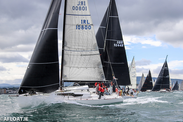 Defending champion Rockabill VI makes a perfectly timed pin end start to the 2021 Dun Laoghaire Dingle Race