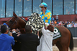 April 11, 2015: American Pharoah with jockey Victor Espinoza on the cell phone after winning the Arkansas Derby at Oaklawn Park in Hot Springs, AR. Justin Manning/ESW/CSM