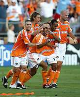 Houston Dynamo players Wade Barrett (24), Kelly Gray (6), Chris Wondolowski (7), Ricardo Clark (13), and Craig Waibel (16) celebrate Chris Wondolowski's 84th minute goal.   Houston Dynamo beat FC Pachuca 2-0 at Robertson Stadium in Houston, TX on March 15, 2007 in the first of a two game series in the CONCACAF Champions' Cup semi-finals.