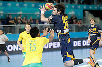 Spain's Antonio Garcia Robledo (r) and Australia's Daniel Kelly during 23rd Men's Handball World Championship preliminary round match.January 15,2013. (ALTERPHOTOS/Acero) /NortePhoto