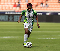 HOUSTON, TX - JUNE 10: Obianujuwan Ikechukwu #18 of Nigeria dribbles the ball during a game between Nigeria and Jamaica at BBVA Stadium on June 10, 2021 in Houston, Texas.