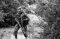 Soldier near the spot where Commander Guerrilla Leschi, head of the Kosovar-Albanian ?Liberation Army for Presevo, Medvedja and Bujanovac (UCPMB). The commander was shot dead by a sniper from the Yugoslav protection forces two days after this photo was taken. Buffer zone between Serbia and Kosovo.<br />