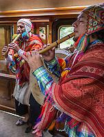 Peru.  Peruvian Quechua Indian Musicians Playing Flutes on Inca Rail Executive Class Train from Ollantaytambo to Machu Picchu.