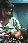 INDIA (West Bengal - Calcutta) -Khuku - Sex worker, feeds her kid at her room in Munsigaunge.- Arindam Mukherjee