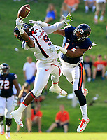 Richmond defensive back Ayo Ogunniyi (9) makes an interception in front of Virginia wide receiver Andre Levrone (14) during the game Saturday Sept. 6, 2014 at Scott Stadium in Charlottesville, VA. Virginia defeated Richmond 45-13. Photo/Andrew Shurtleff