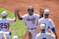 Florida Gators shortstop Richie Martin (12) celebrates after scoring against the Virginia Cavaliers in Game 11 of the NCAA College World Series on June 19, 2015 at TD Ameritrade Park in Omaha, Nebraska. The Gators defeated Virginia 10-5. (Andrew Woolley/Four Seam Images)