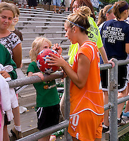 Sky Blue FC  midfielder/forward Kacey White (20) signs autographs for fans after a WPS match at Anheuser-Busch Soccer Park, in St. Louis, MO, June 7, 2009. Athletica won the match 1-0.