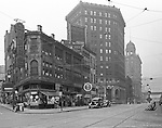 Pittsburgh PA:  View down Liberty Avenue (right) and Market Street (left) from the corner of Sixth Street.  Nearby stores include drug store chain May's, Brass Rail, Weinberger's Discount Drug Store, Dr. Deroy Dentist