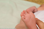 newborn reflex Babinski adult finger touches sole of newborn's foot, toes separate and flare out