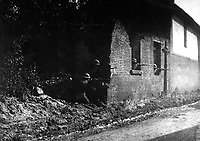 Sharpshooters have good view of enemy from shelter behind old brick wall.  28th Infranty, Bonvillers, France.  May 22, 1918. Pvt Robert Longacre.  (Army)<br /> NARA FILE #:  111-SC-13501<br /> WAR & CONFLICT BOOK #:  616