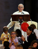 Papa Francesco accarezza un bambino al suo arrivo all'incontro con le famiglie in Piazza San Pietro, Citta' del Vaticano, 26 ottobre 2013.<br /> Pope Francis caresses a child as he arrives for a meeting with families in St. Peter's Square at the Vatican, 26 October 2013.<br /> UPDATE IMAGES PRESS/Riccardo De Luca<br /> <br /> STRICTLY ONLY FOR EDITORIAL USE