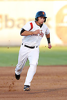 Ryan Tuntland #23 of the Salem-Keizer Volcanoes runs the bases during a game against the Tri-City Dust Devils at Volcanoes Stadium on July 27, 2013 in Keizer, Oregon. Tri-City defeated Salem-Keizer, 5-4. (Larry Goren/Four Seam Images)
