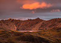 Pristine Lake Angelus with Angelus Hut under dramatic sunset, Nelson Lakes National Park, South Island, New Zealand, NZ