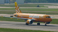 The inaugural flight of Skybus Airlines travels down the runway for takeoff with the Columbus, Ohio, skyline in the background Tuesday, May 22, 2005.  Skybus Airlines Inc., will compete with Southwest Airlines Co., JetBlue Airways Corp. and other low-cost companies.