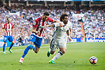 Marcelo Vieira Da Silva (r) of Real Madrid competes for the ball with Yannick Ferreira Carrasco of Atletico de Madrid during their La Liga match between Real Madrid and Atletico de Madrid at the Santiago Bernabeu Stadium on 08 April 2017 in Madrid, Spain. Photo by Diego Gonzalez Souto / Power Sport Images