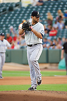 Jordan Pries (23) of the Tacoma Rainiers delivers a pitch to the plate against the Salt Lake Bees in Pacific Coast League action at Smith's Ballpark on July 8, 2014 in Salt Lake City, Utah.  (Stephen Smith/Four Seam Images)