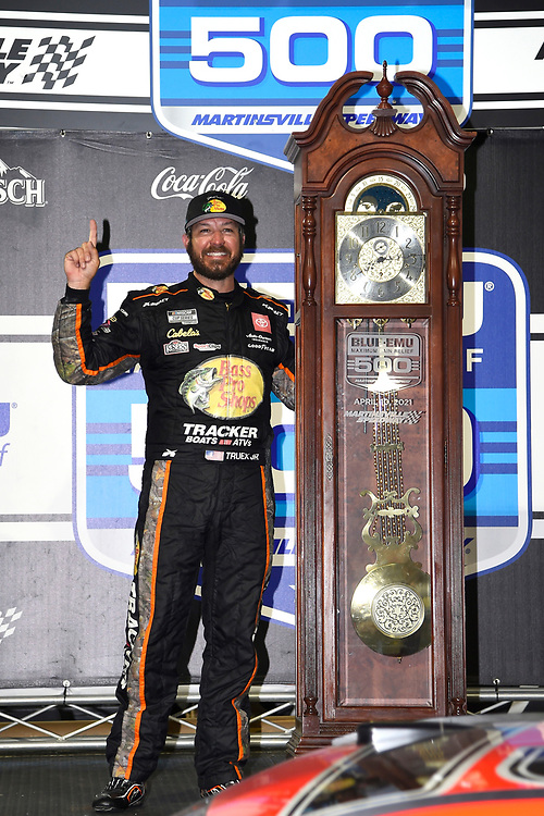 #19: Martin Truex Jr., Joe Gibbs Racing, Toyota Camry Bass Pro, celebrates after winning in Martinsville
