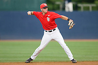 Second baseman Matt Wessinger #0 of the St. John's Red Storm makes a throw to first base against the Virginia Cavaliers at the Charlottesville Regional of the 2010 College World Series at Davenport Field on June 6, 2010, in Charlottesville, Virginia.  The Red Storm defeated the Cavaliers 6-5.   Photo by Brian Westerholt / Four Seam Images