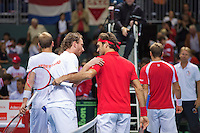 Switserland, Genève, September 19, 2015, Tennis,   Davis Cup, Switserland-Netherlands, Doubles: Matwe Middelkoop and Thiemo de Bakker  (L) are congratulated by FedererChiudinerlli <br /> Photo: Tennisimages/Henk Koster