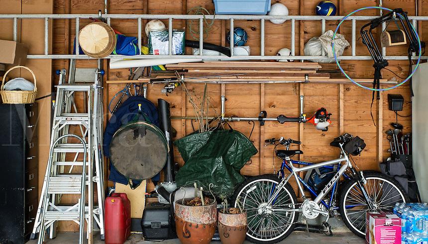 Cluttered interior garage storage.