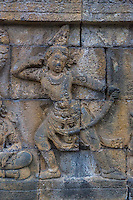 Borobudur, Java, Indonesia.  Detail in Bas-relief Carvings Depicting Scenes from the Life of the Buddha.