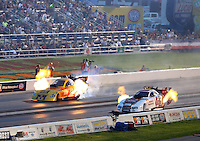 Aug 30, 2014; Clermont, IN, USA; NHRA funny car driver Tommy Johnson (right) races alongside Bob Bode during qualifying for the US Nationals at Lucas Oil Raceway. Mandatory Credit: Mark J. Rebilas-USA TODAY Sports