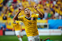BRASILIA - BRASIL -19-06-2014. Foto: Daniel Jayo / Archivolatino<br /> Juan Quintero (#20) jugador de Colombia (COL) celebra un gol anotado a Costa de Marfil (CIV) durante partido del Grupo C de la Copa Mundial de la FIFA Brasil 2014 jugado en el estadio Mané Garricha de Brasilia./ Juan Quintero (#20) player of Colombia (COL) celebrates a goal scored to Ivory Coast (CIV) during the macth of the Group C of the 2014 FIFA World Cup Brazil played at Mane Garricha stadium in Brasilia. Photo:  Daniel Jayo / Archivo Latino<br /> VizzorImage PROVIDES THE ACCESS TO THIS PHOTOGRAPH ONLY AS A PRESS AND EDITORIAL SERVICE IN COLOMBIA AND NOT IS THE OWNER OF COPYRIGHT; ANOTHER USE IS REPONSABILITY OF THE END USER. NO SALES, NO MERCHANDASING. ALL COPYRIGHT IS ARCHIVOLATINO