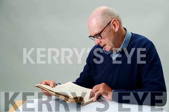 Historian Maurice O'Keeffe with the Kilmorna house visitors book