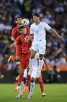 Washington, D.C.- May 29, 2014. Turkey defender Ishak Dogan heads the ball against Honduras midfielder Andy Najar  Turkey defeated Honduras 2-0 during an international friendly game at RFK Stadium.