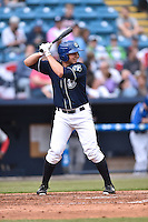 Asheville Tourists third baseman Kevin Padlo (15) awaits a pitch during game one of a double header against the Greenville Drive on April 18, 2015 in Asheville, North Carolina. The Tourists defeated the Drive 2-1. (Tony Farlow/Four Seam Images)