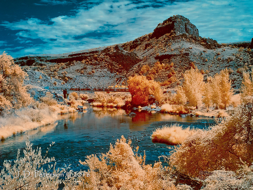 Bridge across Rio Grande, New Mexico (Infrared) ©2016 James D Peterson.  A sunny summer day and a classic New Mexico landscape come alive in the fanciful colors of an infrared image.  This scene, near Taos, is part of the Rio Grande del Norte National Monument.