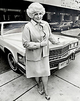 1978<br />  FILE PHOTO - ARCHIVES -<br /> <br /> Founder of Mary Kay Cosmetics Mary Kay Ash, in Toronto for opening of firm's new Canadian headquarters in Mississauga, stands in front of one of major rewards offered top salespersons for her organization, a pink Cadillac. Car is awarded to those whose sales top $100,000 in a year. She started firm 15 years ago.<br /> <br /> <br /> Bezant, Graham<br /> Picture, 1978<br /> <br /> 1978<br /> <br /> PHOTO : Graham Bezant - Toronto Star Archives - AQP