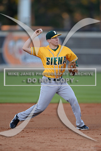 Siena Saints infielder Justin Esquerra (12) during warmups before the season opening game against the Central Florida Knights at Jay Bergman Field on February 14, 2014 in Orlando, Florida.  UCF defeated Siena 8-1.  (Copyright Mike Janes Photography)