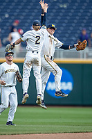 Michigan Wolverines outfielder Jesse Franklin (7) celebrates with teammate Jack Blomgren (2) following  Game 11 of the NCAA College World Series against the Texas Tech Red Raiders on June 21, 2019 at TD Ameritrade Park in Omaha, Nebraska. Michigan defeated Texas Tech 15-3 and is headed to the CWS Finals. (Andrew Woolley/Four Seam Images)