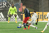 FOXBOROUGH, MA - NOVEMBER 1: Donovan Pines #23 of DC United comes in to tackle Adam Buksa #9 of New England Revolution during a game between D.C. United and New England Revolution at Gillette Stadium on November 1, 2020 in Foxborough, Massachusetts.