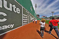 "9 June 2012: Washington Nationals executives approach the ""Green Monster"" during the inter league series against the Boston Red Sox at Fenway Park in Boston, MA. The Nationals defeated the Red Sox 4-2 in the second game of their 3-game series. Mandatory Credit: Ed Wolfstein Photo"