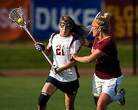 Anne Thomas (21) of Virginia is checked by Allie Emala (22) of Virginia Tech during the first round of the ACC Women's Lacrosse Championship in College Park, MD.  Virginia defeated Virginia Tech, 18-6.
