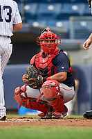 Lowell Spinners catcher Alberto Schmidt (20) looks into the dugout during a game against the Staten Island Yankees on August 22, 2018 at Richmond County Bank Ballpark in Staten Island, New York.  Staten Island defeated Lowell 10-4.  (Mike Janes/Four Seam Images)